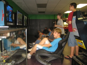 The boys from group 2 in the midst of a full-fledged video game stupor at Game Underground.
